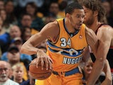 JaVale McGee of the Denver Nuggets controls the ball against Robin Lopez #42 of the Portland Trail Blazers at Pepsi Center on November 1, 2013