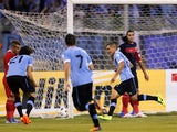 Uruguay's defender Maxi Pereira celebrates after scoring the opening goal for his team during their FIFA 2014 World Cup qualifier football match against Jordan at the International Stadium on November 13, 2013