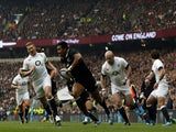 New Zealand's wing Julian Savea runs in to score the opening try during the international rugby union test match between England and New Zealand at Twickenham Stadium on November 16, 2013