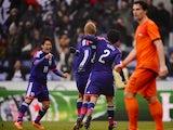 Japan midfielder Keisuke Honda celebrates after scoring against the Netherlands on November 16, 2013