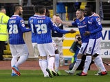 Liam Noble of Carlisle United celebrates with team-mates after he scored the first goal from the penalty spot during the Sky Bet League one match against Crawley Town at Brunton Park on November 16, 2013