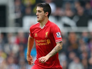 Luis Alberto of Liverpool in action during the Barclays Premier League match between Newcastle United and Liverpool at St James' Park on October 19, 2013