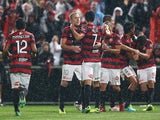 Wanderers players celebrate the goal to Mark Bridge during the round six A-League match between the Western Sydney Wanderers and the Melbourne Victory on November 16, 2013