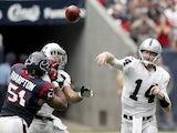 Matt McGloin of the Oakland Raiders completes a pass against the Houston Texans on November 17, 2013