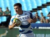 Scotland's player Matt Scott runs to score a try during the Scotland-Italy match, the first match of the Castle Lager Incoming Series at Loftus Satdium in Pretoria on June 22, 2013
