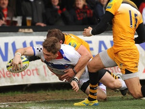 Matthew Pewtner of Newport Gwent Dragons scores a try during the LV= Cup match between Newport Gwent Dragons and London Wasps at Rodney Parade on November 16, 2013