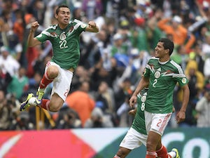 Mexico's forward Paul Aguilar celebrates after scoring against New Zealand during their FIFA World Cup intercontinental play-off football match in Mexico City on November 13, 2013