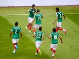 Mexico's forward Raul Jimenez celebrates with teammates after scoring their second goal against New Zealand during their FIFA World Cup intercontinental play-off football match in Mexico City on November 13, 2013
