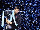 Novak Djokovic poses with the ATP World Tour Finals trophy on November 11, 2013.