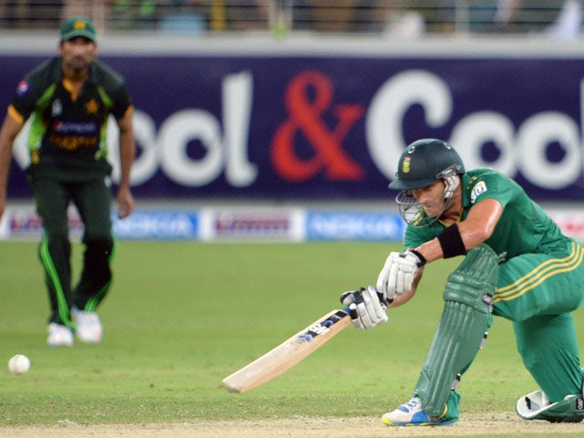 South African captain Faf du Plessis plays a shot during the First T20 International at Dubai stadium on November 13, 2013.