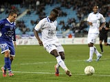 Auxerre's Paul-Georges Ntep de Madiba controls the ball in front of Bastia's French defender Gilles Cioni during the French League Cup football match Bastia (SCB) vs Auxerre (AJA) in the Armand Cesari stadium in Bastia, Corsica, on November 7, 2012
