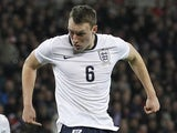 England's defender Phil Jones shoots wide of the goal during the international friendly football match between England and Chile at Wembley in north London on November 15, 2013