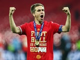 Bayern Munich captain Philipp Lahm celebrates winning the Champions League at Wembley Stadium on May 25, 2013