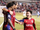 Robbie Findley #10, Devon Sandoval #49 and Sebastian Velasquez #26 of Real Salt Lake celebrate a goal during a game against the Portland Timbers during the first half of the Western Conference Championship MLS soccer game - leg 1, on November 10, 2013
