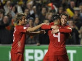 Portugal's forward Cristiano Ronaldo celebrates with teammates after scoring a goal during the FIFA 2014 World Cup qualifier play-off first leg football match Portugal vs Sweden at the Luz stadium in Lisbon on November 15, 2013