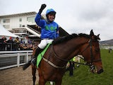 Ruby Walsh celebrates victory onboard Hurricane Fly after winning the Champion Hurdle Challenge Trophy race on March 12, 2013
