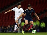 United States' Sacha Kljestan chases Scotland's Charlie Mulgrew during the international friendly football match between Scotland and the United States of America at Hampden Park in Glasgow on November 15, 2013
