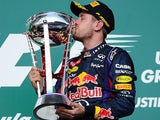 Red Bull Racing's German driver Sebastian Vettel kisses the trophy after winning the United States Formula One Grand Prix at Circuit of The Americas on November 17, 2013