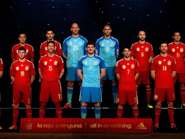 The Spain football team unveil their new all-red football kit in Madrid on November 13, 2013