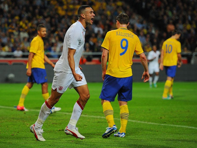 Steven Caulker of England celebrates scoring to make it 2-1 during the international friendly match between Sweden and England at the Friends Arena on November 14, 2012