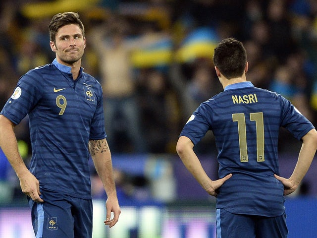France's forward Olivier Giroud reacts next to midfielder Samir Nasri after Ukraine scored a goal during the 2014 FIFA World Cup qualifying play-off first leg football match between Ukraine and France at the Olympic Stadium in Kiev on November 15, 2013
