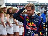 Red Bull Racing's German driver Sebastian Vettel walks off the circuit after winning the qualifying session for the United States Formula One Grand Prix at Circuit of The Americas on November 16, 2013