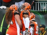 Vontaze Burfict of the Cincinnati Bengals celebrates with Domata Peko after returning a fumble for a touchdown during the NFL game against the Cleveland Browns on November 17, 2013