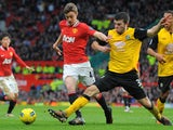 Manchester United's English striker William Keane vies with Blackburn Rovers' Scottish defender Grant Hanley during the English Premier League football match between Manchester United and Blackburn Rovers at Old Trafford in Manchester, north-west England
