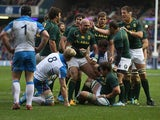 South Africa's Willem Alberts is congratulated by team mates after scoring the opening try against Scotland during their International match on November 17, 2013