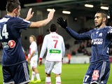 Marseille's French forward Dimitri Payet is congratulated after scoring a goal during the French L1 football match Ajaccio vs Marseille on November 22, 2013