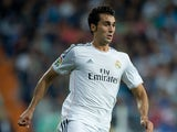 Alvaro Arbeloa of Real Madrid CF controls the ball during the La Liga match between Real Madrid CF and Club Atletico de Madrid at Estadio Santiago Bernabeu on September 28, 2013