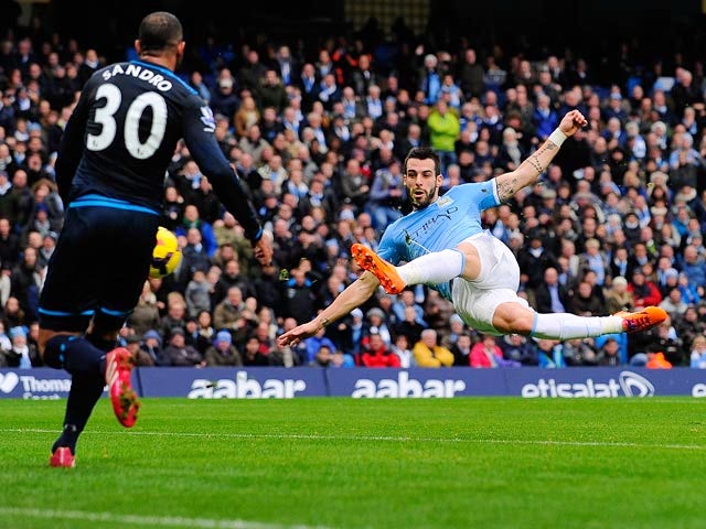 Man City's Alvaro Negredo shoots leading to the second goal against Tottenham on November 24, 2013