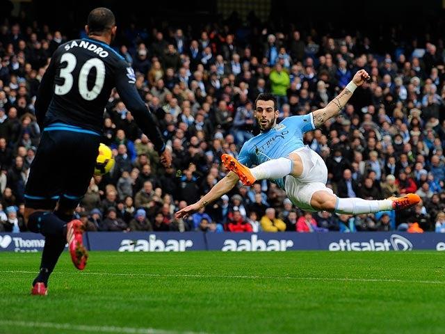 Man City's Alvaro Negredo shoots leading to the second goal against Tottenham on November 24, 2013