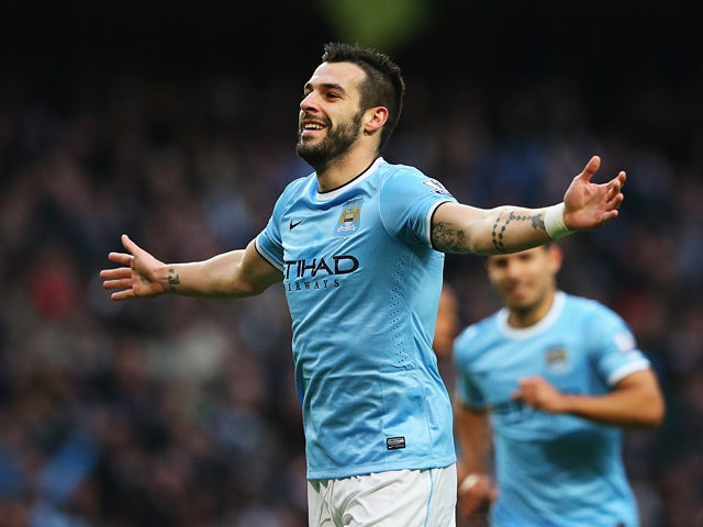 Mac City's Alvaro Negredo celebrates after scoring his team's fifth goal and his second of the match against Tottenham on November 24, 2013