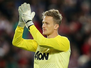Goalkeeper Anders Lindegaard of Manchester United acknowledges the crowd at fulltime during the match between the A-League All-Stars and Manchester United at ANZ Stadium on July 20, 2013
