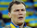 Ukraine's goalkeeper Andriy Pyatov listens to the national anthems before the start of a World Cup 2014 play-off first-leg football match between Ukraine and France in Kiev on November 15, 2013
