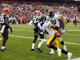 Wide receiver Antonio Brown of the Pittsburgh Steelers celebrates after scoring a touchdown with Jerricho Cotchery against the Cleveland Browns on November 24, 2013