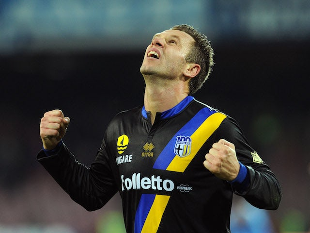 Antonio Cassano of Parma celebrates afer scoring the opening goal during the Serie A match between SSC Napoli and Parma FC at Stadio San Paolo on November 23, 2013