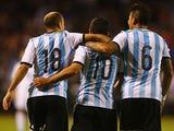 Teammates congratulate Sergio Aguero #10 of Argentina after Aguero scored his second goal of the match during the international friendly match between Bosnia-Herzegovina and Argentina at Busch Stadium on November 18, 2013