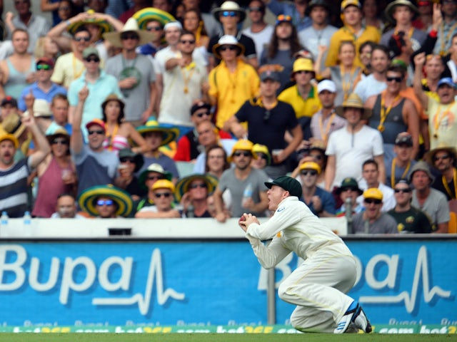 Australia's Chris Rogers takes a catch off England's batsman Stuart Broad at the boundary line to wind up England's first innings during day two of the first Ashes cricket Test match between England and Australia at the Gabba Cricket Ground in Brisbane on