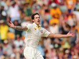 Mitchell Johnson of Australia celebrates after dismissing Joe Root of England during day two of the First Ashes Test match between Australia and England at The Gabba on November 22, 2013