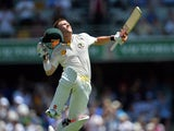 Australia's batsman David Warner jumps in air to celebrates his unbeaten century during day three of the first Ashes cricket Test match between England and Australia at the Gabba Cricket Ground in Brisbane on November 23, 2013