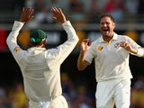 Ryan Harris of Australia celebrates dismissing Michael Carberry of England during day three of the First Ashes Test match between Australia and England at The Gabba on November 23, 2013