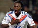 Lyon's French forward Bafetimbi Gomis celebrates after scoring a goal during the French L1 football match against Valenciennes on November 23, 2013
