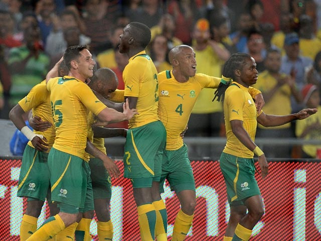 South Africa's Bernard Parker is congratulated by teammates after scoring the opening goal against Spain during an international friendly match on November 19, 2013