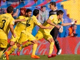 Villarreal's Bruno Soriano celebrates with teammates after scoring the opening goal via the penalty spot against Levante on November 24, 2013