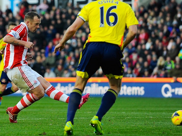 Stoke City's midfielder Charlie Adam scores the opening goal during the English Premier League football match between Stoke City and Sunderland on November 23, 2013