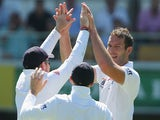 Chris Tremlett of England celebrates with team mates after dismissing Steve Smith of Australia during day one of the First Ashes Test match on November 21, 2013