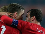 Austria's Christian Fuchs congratulates teammate Marc Janko after scoring the opening goal against USA during their international friendly match on November 19, 2013
