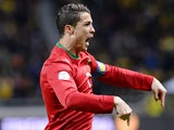 Portugal's Cristiano Ronaldo celebrates after scoring the opening goal against Sweden during their World Cup play-off match on November 19, 2013